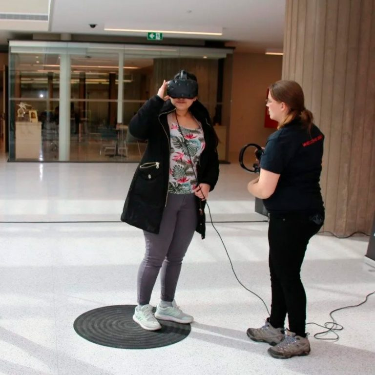 Woman conducting VR research.
