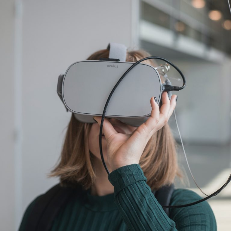 Woman wearing oculus headset.